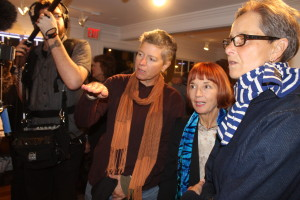 Jane Anderson, center, award-winning playwright, screenwriter and director, talks about the work of her great-aunt Edith Lake Wilkinson at the Larkin Gallery last Friday as a documentary crew records the moment.