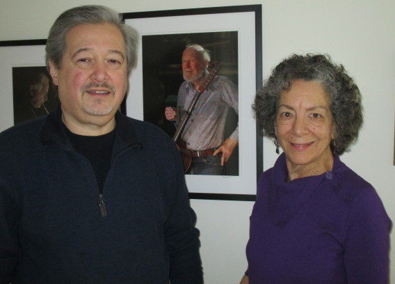 John Economos and Maxine Smith - The Econosmiths in front of one of their photos of the legendary Pete Seeger.