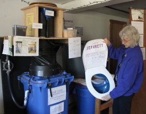 Hilda Maingay looks at the Separett toilet which uses a bin similar in size to a standard garbage can or recycling container for composting.