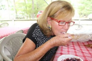 Carol Wilgus of Cotuit enjoys a piece of blueberry apple pie at the Autumn in Old Cotuit festival.