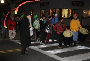 Al Moniz stops traffic on Main Street in Falmouth for a New Year's Eve procession.