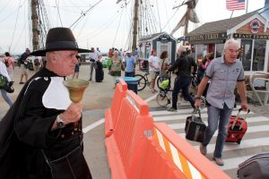 Provincetown Town Crier Ken Lonergan greets visitors to Provincetown as they arrive on the fast ferry from Boston.