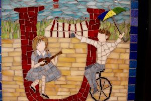 """Children can look for words that begin with the featured letter in every panel, including the unicycle and ukulele in the """"U"""" panel."""