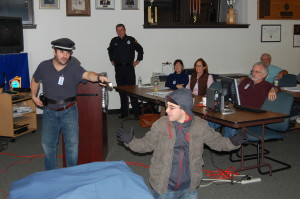 In a role-playing exercise, a class member follows protocol when interrupting a criminal in the middle of a crime.