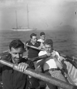 "Bill Cooper, right foreground, rows with a crew in the whaleboat that served as a lifeboat in the ""Atlantis."""