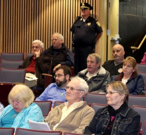 Bill Cronin (sitting on the aisle, third row back), president of the Greater Hyannis Civic Association, listens at a fire district meeting.