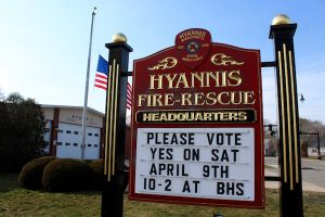The Hyannis Fire Station sign urges voters to support a new station.