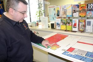 Hyannis Fire EMS Supervisor Michael Medeiros shows plans for the new fire station.