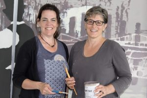 Jackie Reeves and Mary-Ann Agrestic are the artists behind the new mural on Pleasant Street in Hyannis.
