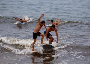 How about two of us on that board? It can be done -- at the Cape Cod Oldtimers Longboard Classic.